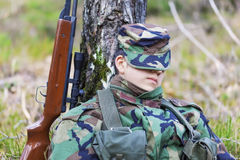 Young recruit with optical rifle in forest Royalty Free Stock Photography