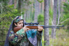 Young recruit with optical rifle in forest Stock Image