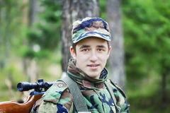 Young recruit with optical rifle in forest Stock Photography