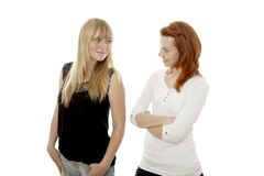 Young red and blond haired girls like each other Stock Photos