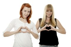 Young red and blond haired girls singing hearts Stock Images