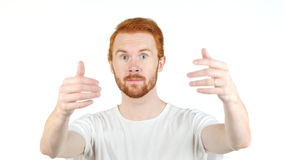 Young Red Hair Beard man offering new deal , inviting. High quality Stock Images