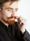 Young red hair man with beard and mustache in black suit on white background Royalty Free Stock Photos