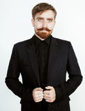 Young red hair man with beard and mustache in black suit on white background Stock Photos