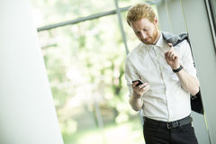 Young red hair man. With a phone Stock Image