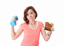 Young Red Hair Sport Woman lifting weight and cake Stock Photography