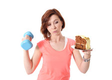 Young Red Hair Sport Woman lifting weight and cake Royalty Free Stock Photography