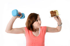 Young Red Hair Sport Woman lifting weight and cake Stock Photo
