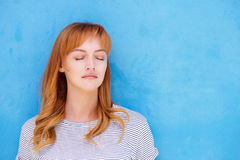 Young red hair woman with eyes closed. Close up portrait of serious woman standing with eyes closed in contemplation royalty free stock photos