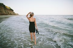 A young red hair woman near sea waves Royalty Free Stock Images