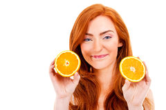 Young red hair woman with oranges Royalty Free Stock Photos