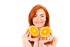 Young red hair woman with oranges Stock Photo
