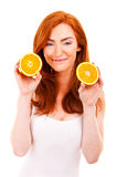 Young red hair woman with oranges Stock Image