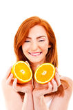 Young red hair woman with oranges Royalty Free Stock Image