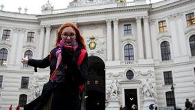 Young red hair woman using cell phone in Vienna, wide angle. Wide angle stock footage