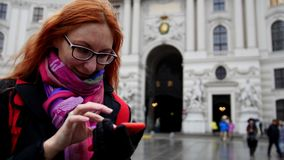 Young red hair woman using cell phone in Vienna, wide angle, close up. Wide angle stock footage