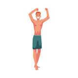 Young red haired athletic man in swimming shorts dancing Royalty Free Stock Photo