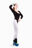 Young red-haired athletic woman is posing in black and white training clothing Stock Image