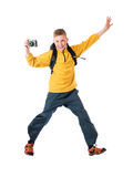 Young red-haired boy in a yellow jacket and a backpack holding an old camera and smiling Royalty Free Stock Photos