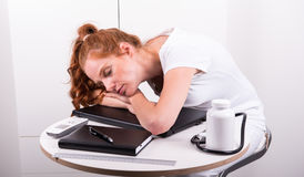 Young red-haired doctor has fallen asleep because of overworked.  Stock Image