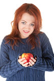 Young red-haired girl in a blue sweater with an ap Stock Photography