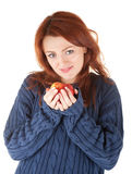 Young red-haired girl in a blue sweater with an ap Royalty Free Stock Photo