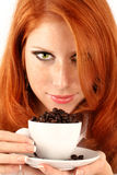 Young red-haired girl and coffee Royalty Free Stock Photo