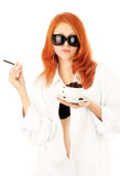 Young red-haired girl and coffee Stock Photos