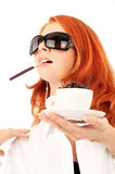 Young red-haired girl and coffee Royalty Free Stock Image