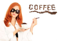 Young red-haired girl and coffee Royalty Free Stock Images