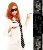 Young red-haired girl and coffee Royalty Free Stock Photography