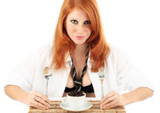Young red-haired girl and coffee grinder Stock Images