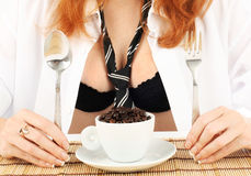 Young red-haired girl and coffee grinder Stock Image