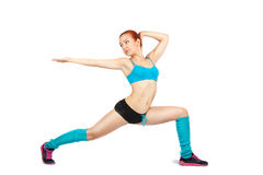 Young red-haired girl doing exercises Stock Photo
