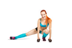 Young red-haired girl doing exercises Stock Photography