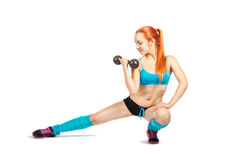 Young red-haired girl doing exercises Royalty Free Stock Photo