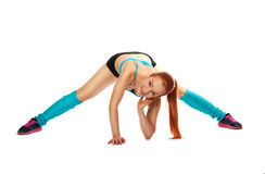 Young red-haired girl doing exercises Royalty Free Stock Images