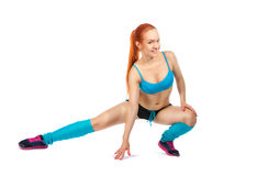 Young red-haired girl doing exercises Royalty Free Stock Photography