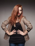 Young red-haired girl in a leather jacket represen. Portrait of the young girl in a leather jacket representing model stock images
