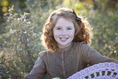 Young red haired girl outdoors Royalty Free Stock Image