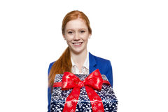 Young red haired Girl presenting a gift Stock Image