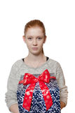 Young red haired Girl presenting a gift Royalty Free Stock Image