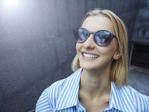Young blonde-haired girl in sunglasses with dark glasses in a frame, day, outdoor royalty free stock photos