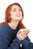 Young red-haired girl with a white cup in his hand Royalty Free Stock Photo