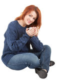 Young red-haired girl with a white cup in his hand Stock Photography