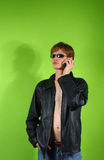 Young red-haired guy with the phone Royalty Free Stock Image