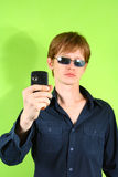 Young red-haired guy with the phone Royalty Free Stock Photo