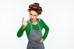 Young red haired housewife blames and scolds looking at camera Royalty Free Stock Images