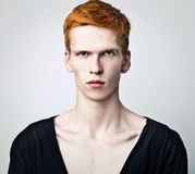Young red haired man on light background. Royalty Free Stock Image