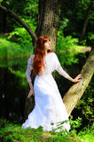Young red-haired pretty woman Royalty Free Stock Photography